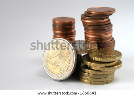 Euro coins in piles isolated over white background