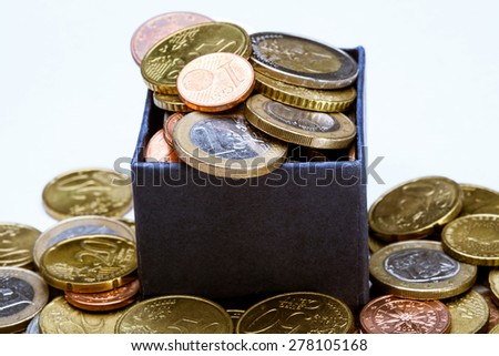 Euro coins in the blue box, macro shot - stock photo