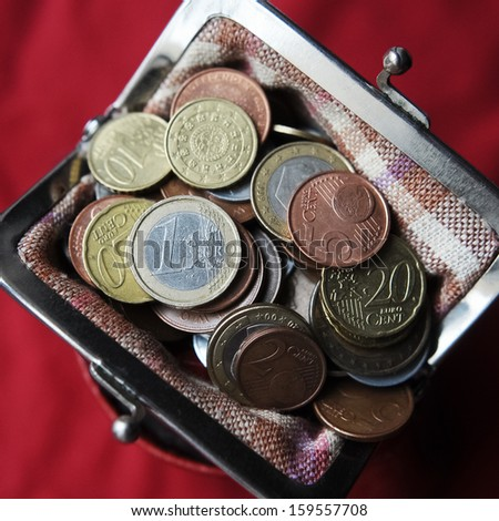 Euro coins in the wallet - stock photo