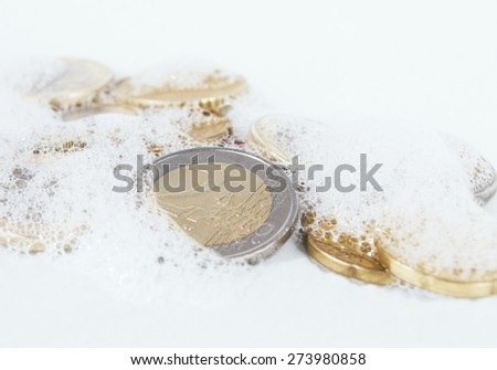 Euro coins in white soapy foam