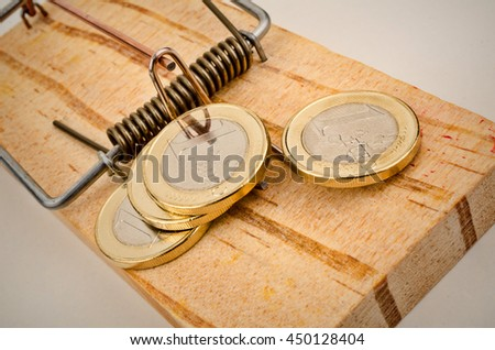 Euro coins on a mouse trap, a concept representing the currrent troubles of the European currency - stock photo