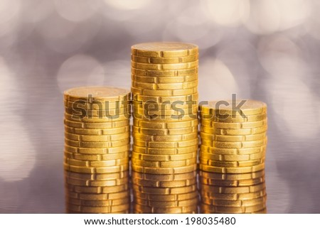 Euro coins on abstract background