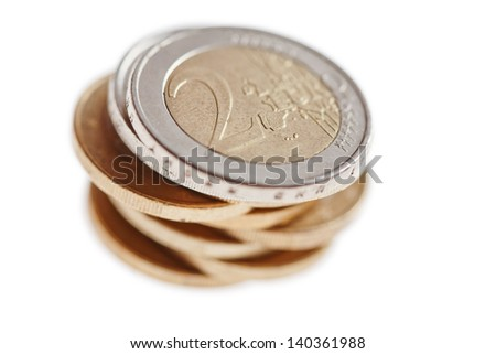 euro coins stacked isolated on white - stock photo