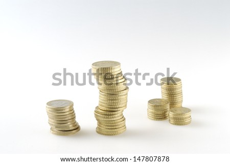 euro coins stacked on white background