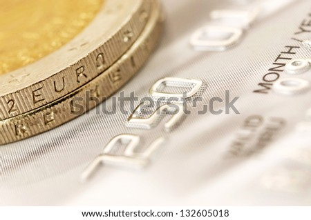 Euro coins with credit card - stock photo