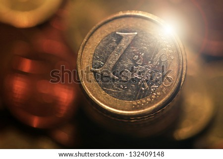 Euro coins with lens flare. Selective focus. - stock photo