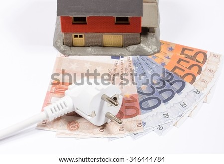 Euro currency and plug. Concept of saving electricity at home.  - stock photo