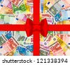 euro currency banknotes with red gift ribbon and bow. european money background - stock photo