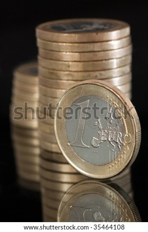 Euro currency. Several 1 Euro coins.