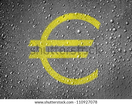 Euro currency sign painted on metal surface covered with rain drops