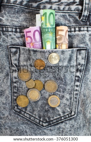 euro dollars in the jeans pocket. European money - stock photo