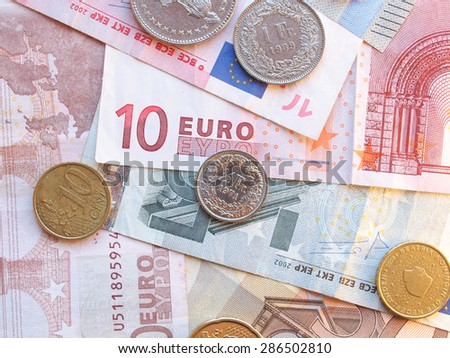 Euro (EUR) and Swiss Franc (CHF) banknotes and coins - legal tender of the European Union - stock photo
