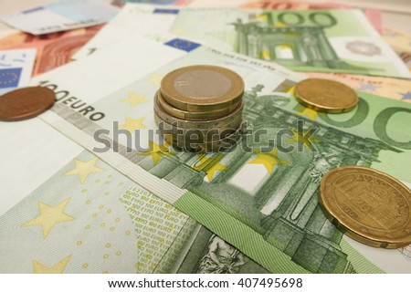 Euro (EUR) banknotes and coins - legal tender of the European Union - stock photo