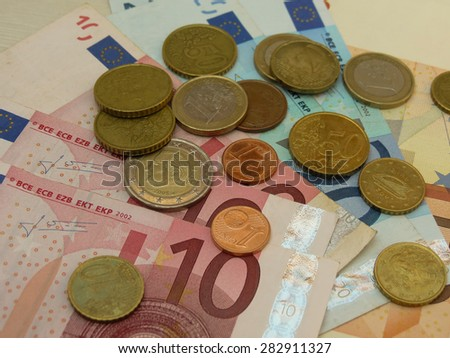 Euro EUR banknotes and coins money useful as a background or money concept