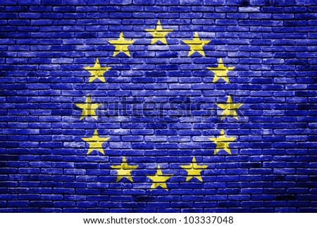 euro flag painted on old brick wall texture background - stock photo