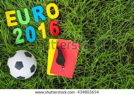Euro 2016 football championship - image with ball, referee yellow, red card on green lawn. Symbol of soccer and fair play. Empty space for text - stock photo