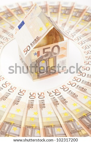 Euro house and banknotes - stock photo