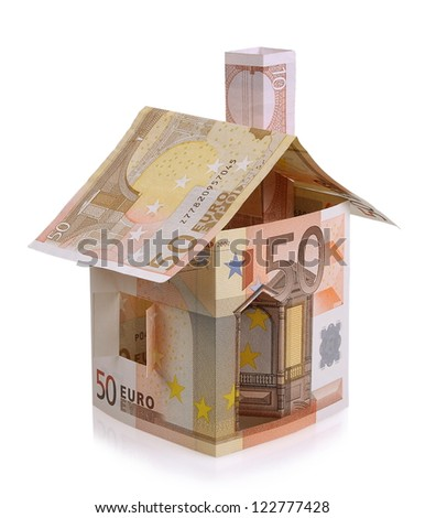 Euro house made from banknotes on white background - stock photo