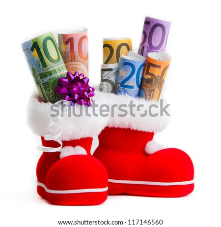 Euro in boot of Santa Claus white background - stock photo