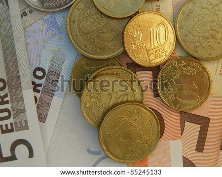 Euro (legal tender of the European Union) banknotes and coins - stock photo