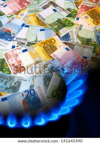 EURO money and gas stove - stock photo