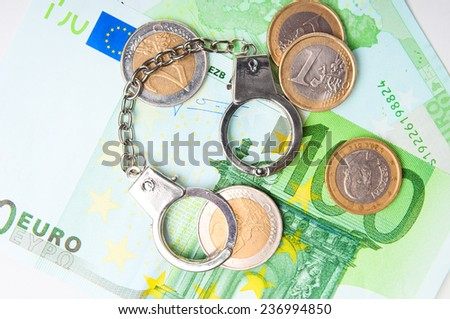 Euro money and  handcuffs closeup - stock photo