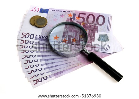 Euro money and magnifying glass - stock photo