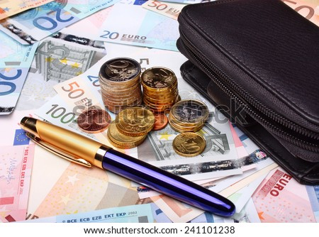 Euro money and wallet on money background - stock photo