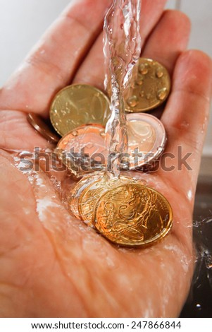 Euro money and water, with rich colors and lighting. Great for finance, business and economy themes.  - stock photo