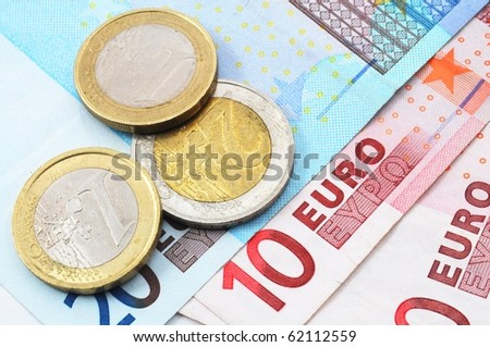 euro money background with coins and bills - stock photo