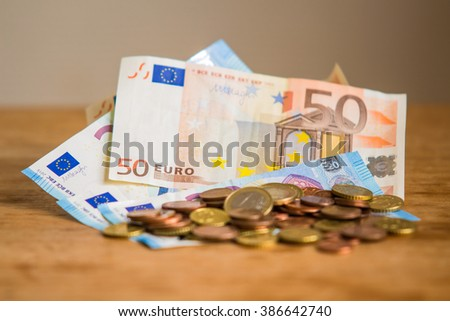Euro money, banknotes and coins, on the table - stock photo