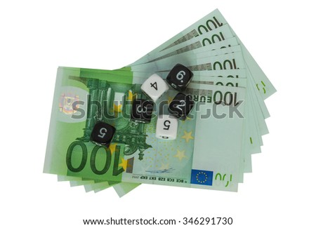 Euro money banknotes and dice isolated on a white background, gambling concept, top view