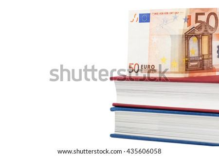 Euro money banknotes on books over white background. Isolated with clipping paths. Focus on left part of the books and banknote - stock photo