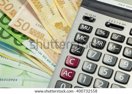 Euro money bills and calculator for finance and economic