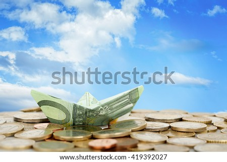 euro money boat on coins, abstract money concept
