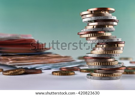 Euro money: closeup of banknotes and coins,stacked on each other in different positions. - stock photo