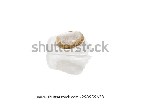 Euro money frozen in ice cubes isolated on white background. Frozen account, melting economy and transparent money flow.  - stock photo