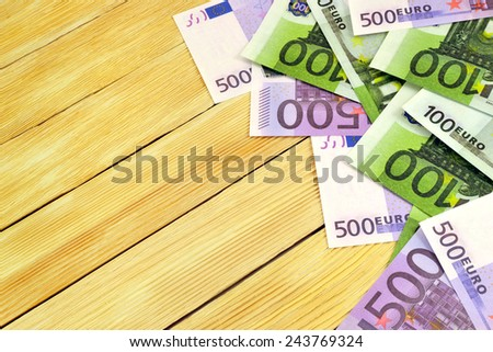 Euro money image on the background wooden boards - stock photo