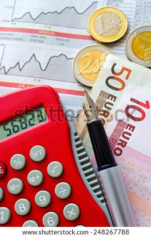 Euro money in office - euro coins and pocket calculator - business and finance - stock photo