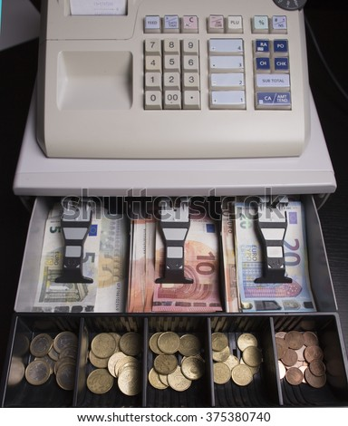 Euro money in the till - stock photo