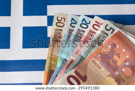 Euro money on the background of the Greece flag.greece crisis - stock photo