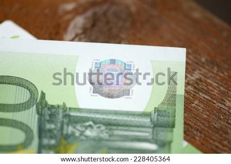 euro money on wooden plank - stock photo