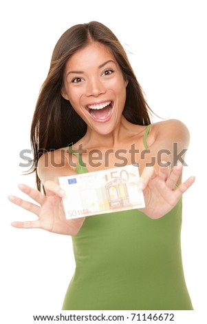 Euro money woman showing 50 euro bill happy and excited isolated on white background. Pretty casual Asian woman winner. - stock photo