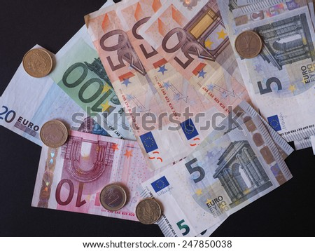 Euro notes and coins EUR - Legal tender of the EU - stock photo
