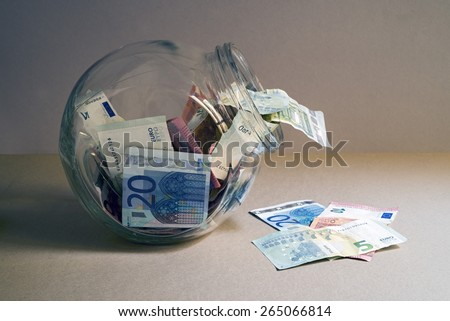 Euro notes in a glass jar. Space for copy - stock photo