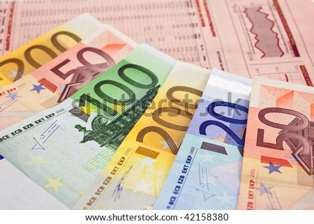 euro notes on a financial newspaper. closeup. small GRIP - stock photo