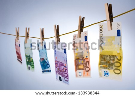 Euro notes on clothesline - stock photo