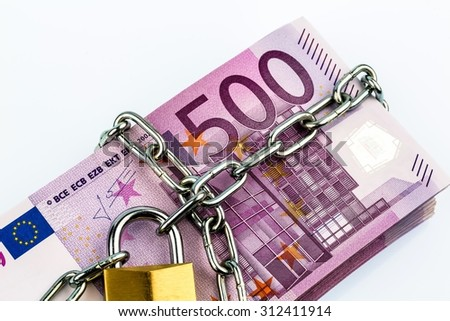 euro notes with chain and padlock. symbolic photo for security and inflation. - stock photo