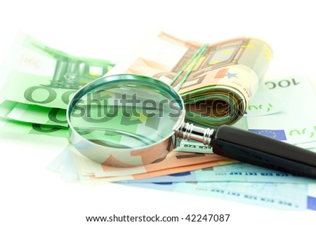 euro notes with magnifier on white background. small GRIP - stock photo