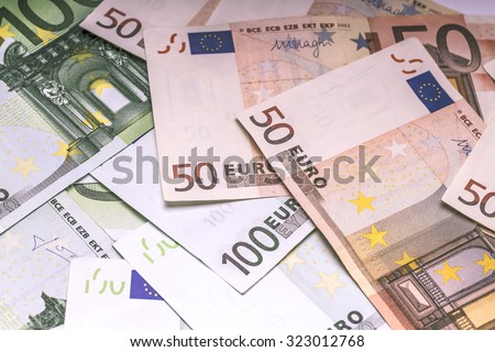 Euro paper money: closeup of banknotes, fifty, hundred, finances, investment, business, background, texture. - stock photo